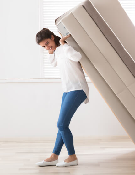 woman moving furniture | Great Western Flooring Co.