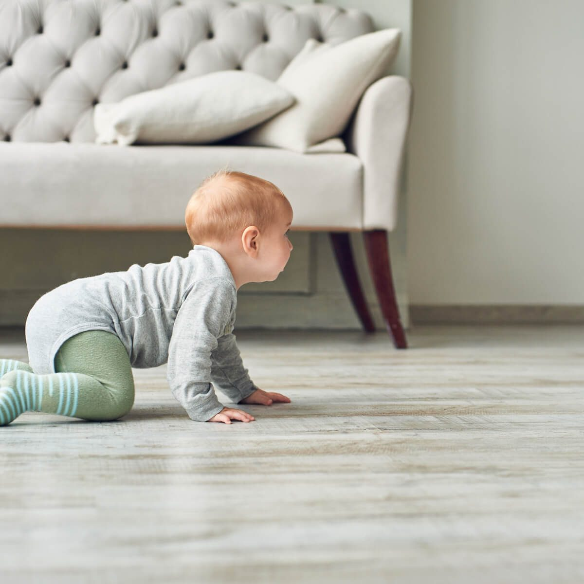 baby on luxury vinyl floor | Great Western Flooring Co.